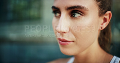 Buy stock photo Shot of a young woman going for a workout in the city