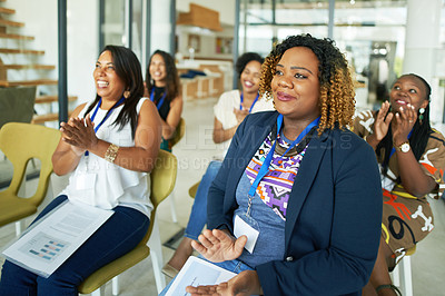 Buy stock photo Cropped shot of a group of young businesswomen applauding during a presentation at a conference