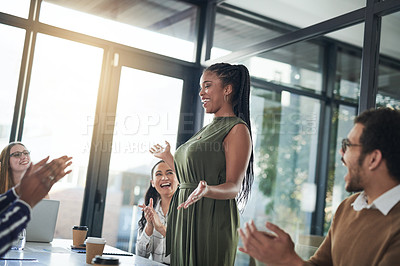 Buy stock photo Cropped shot of a cheerful young businesswoman receiving applause from her work colleagues during a meeting inside of the boardroom