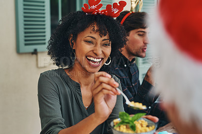 Buy stock photo Shot of beautiful young woman enjoying herself at Christmas lunch party with friends and family