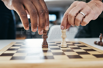 Buy stock photo Shot of two unrecognizable businesspeople playing a game of chess together inside their office at work