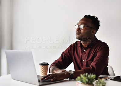 Buy stock photo Cropped shot of a handsome young businessman looking contemplative while sitting alone at his desk in the office