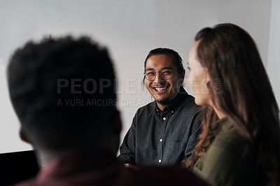 Buy stock photo Cropped shot of a group of young businesspeople sitting and having a meeting in the offic