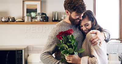 Buy stock photo Shot of a young man surprising his wife with a bunch of roses at home