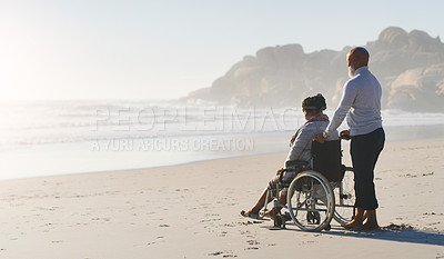 Buy stock photo Full length shot of an attractive senior woman sitting in a wheelchair as her husband stands beside her