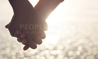 Buy stock photo Cropped shot of an unrecognizable senior couple holding hands affectionately on the beach during the day