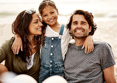 Buy stock photo Portrait of a beautiful young family of three spending the day together at the beach