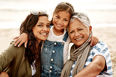 Buy stock photo Portrait of an adorable little girl spending the day with her mother and grandmother at the beach