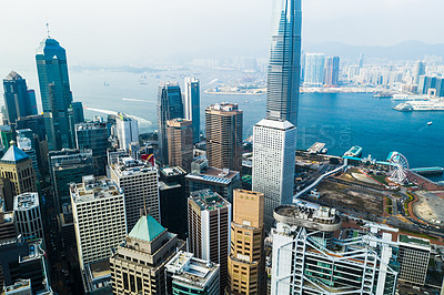 Buy stock photo Aerial shot of skyscrapers, office blocks and other commercial buildings in a busy coastal city