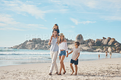 Buy stock photo Full length portrait of an affectionate couple holding hands with their two young children and walking along the beach