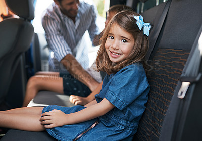 Buy stock photo Cropped portrait of a young girl sitting in the car and waiting to go on a roadtrip with her family