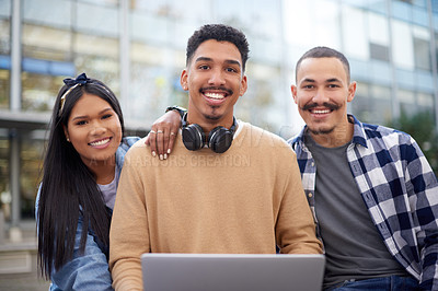 Buy stock photo Shot of a group of young students using a laptop together at university
