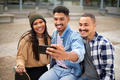 Buy stock photo Shot of a group of young students taking a selfie with a smartphone at university