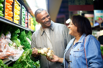 Buy stock photo Cropped shot of a mature couple out shopping together in a grocery store