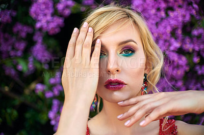Buy stock photo Shot of a glamorous young woman gesturing with her hands outdoors