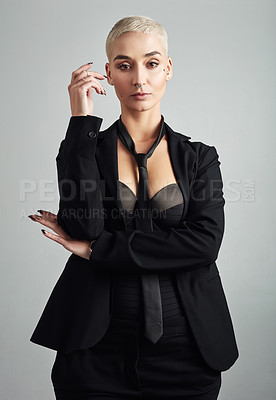 Buy stock photo Portrait of an attractive young businesswoman in lingerie posing against grey background