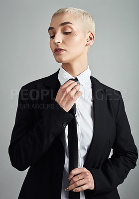 Buy stock photo Shot of an attractive young businesswoman posing against a grey background