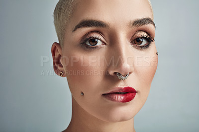 Buy stock photo Portrait of a beautiful young woman posing against a grey background