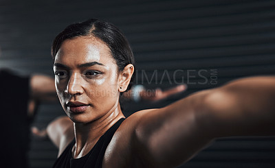 Buy stock photo Shot of a sporty young woman exercising with her partner in the background