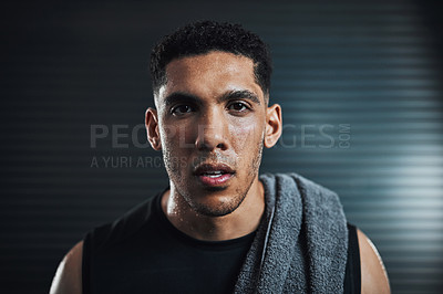 Buy stock photo Portrait of a sporty young man sweating after his workout