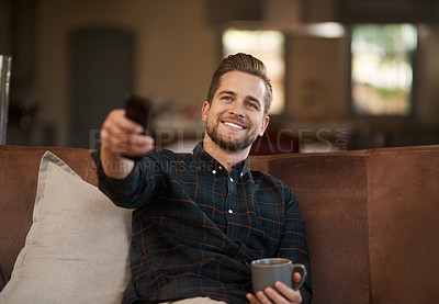 Buy stock photo Cropped shot of a young man relaxing on the sofa at home