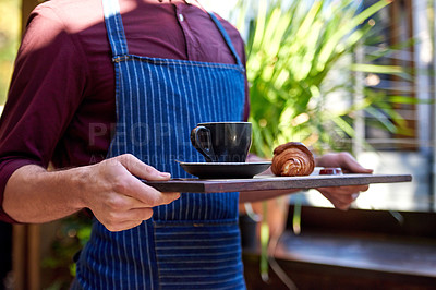 Buy stock photo Shot of an unrecognizable female barista serving food and drinks at her outdoor cafe