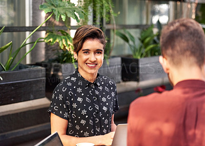 Buy stock photo Portrait of an attractive young businesswoman having a meeting with a client at an outdoor cafe