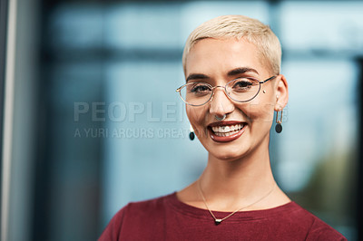 Buy stock photo Cropped portrait of an attractive young businesswoman wearing spectacles and standing alone in her office