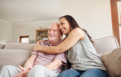 Buy stock photo Shot of a young woman spending quality time with her elderly father at home