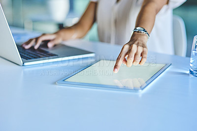 Buy stock photo Closeup shot of an unrecognisable businesswoman using a digital tablet and laptop in an office