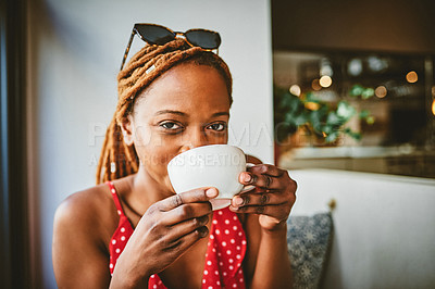 Buy stock photo Portrait of an attractive young woman enjoying a cup of coffee at a cafe