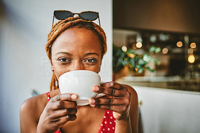 Buy stock photo Portrait of an attractive young woman enjoying a cup of coffee at  cafe