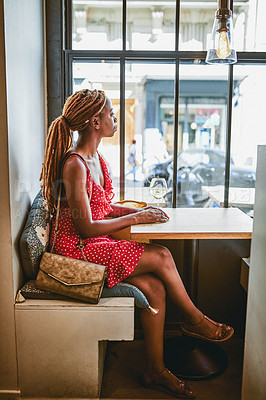 Buy stock photo Full length shot of an attractive young woman looking thoughtful while enjoying a glass of wine inside a cafe