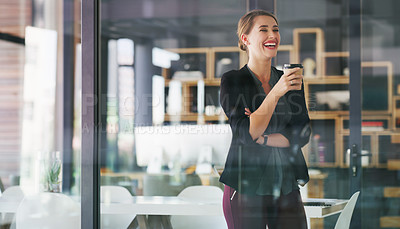 Buy stock photo Cropped shot of an attractive young businesswoman standing alone in her office and holding a cup of coffee