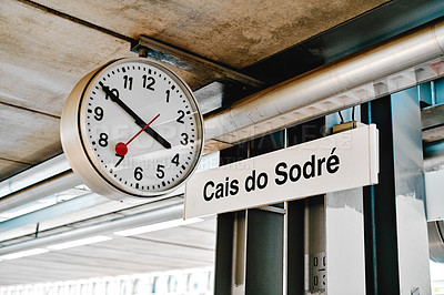 Buy stock photo Cropped shot of a round clock hanging outside the train station of Cais do Sodre in Portugal