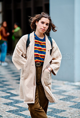 Buy stock photo Cropped portrait of an attractive young woman posing alone along the streets of Portugal during the day