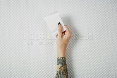 Buy stock photo Studio shot of an unrecognizable woman holding a sanitary pad against white background