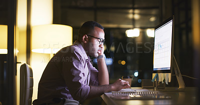 Buy stock photo Shot of a handsome young businessman fast asleep at his desk during a late shift at the office