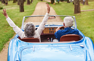Buy stock photo Rearview shot of a senior couple out on a road trip on a sunny day