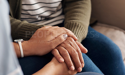 Buy stock photo Cropped shot of an unrecogniziable nurse aid sitting and holding hands with her senior patient in a nursing home