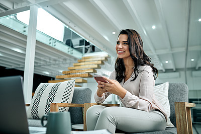 Buy stock photo Cropped shot of an attractive young businesswoman sitting alone in her office and using her cellphone