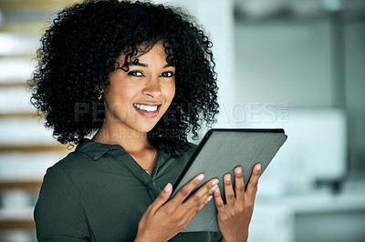 Buy stock photo Cropped portrait of an attractive young businesswoman standing alone in her office and using a tablet