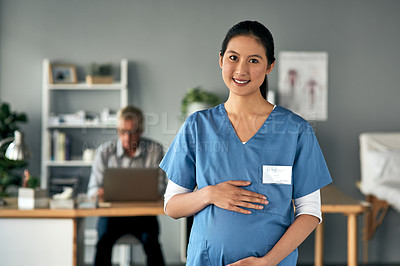 Buy stock photo Shot of a pregnant medical practitioner standing in a modern office