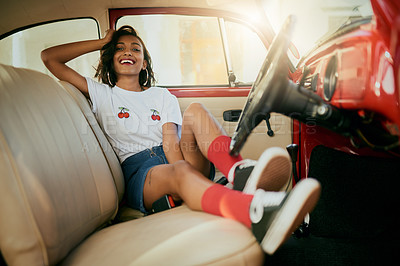 Buy stock photo Full length portrait of an attractive young woman sitting in her car before going on a road trip alone