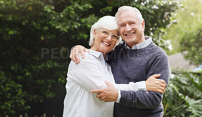 Buy stock photo Portrait of a happy senior couple posing together outdoors