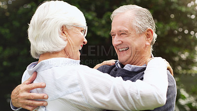 Buy stock photo Shot of a happy senior embracing and spending time together outdoors