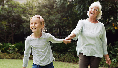 Buy stock photo Shot of an adorable little girl spending the day with her grandmother outdoors