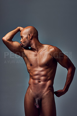 Buy stock photo Studio shot of a muscular young man kissing his bicep while posing nude against a grey background