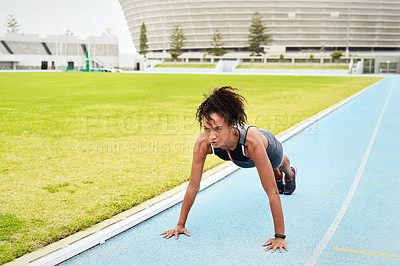 Buy stock photo Full length shot of an attractive young female athlete planking while out on the track