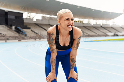 Buy stock photo Cropped shot of an attractive young female athlete down on her haunches after a workout at the track